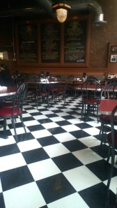 Wazee Supper Club's familiar checkerboard floor. The benches along the back wall were sat on during the funeral of Buffalo Bill Cody. Pull that fact out when you're eating there. Photo courtesy CDM Communications.