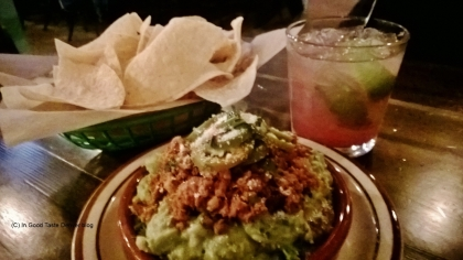 Chips and salsa, a Pomegranate Caipirinha cocktail and a mound of nachos. Life is good at Los Chingones.