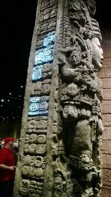 """One of two, towering """"Stelae"""" made tall like maize. Projected illuminations help visitors understand what they are seeing at """"Maya: Hidden Worlds Revealed"""" at the Denver Museum of Nature and Science."""